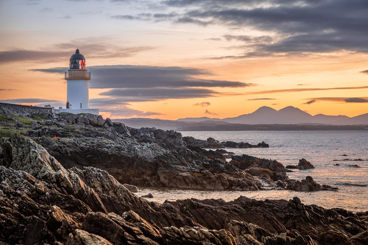Scottish lighthouse on a rocky beach
